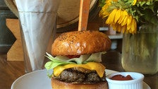 Dry-aged beef burger with French fries at Republique